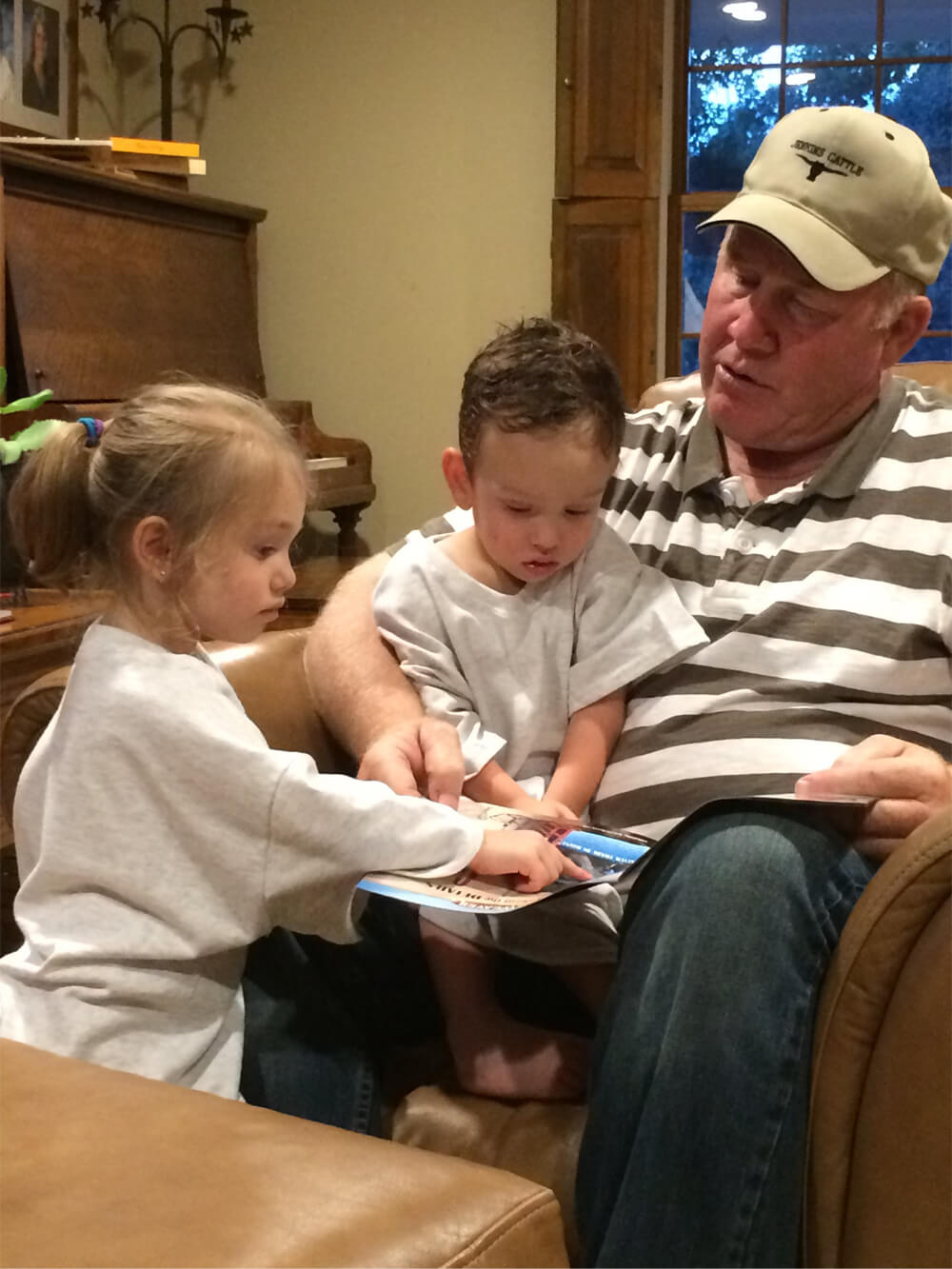 Russell reading to grandchildren